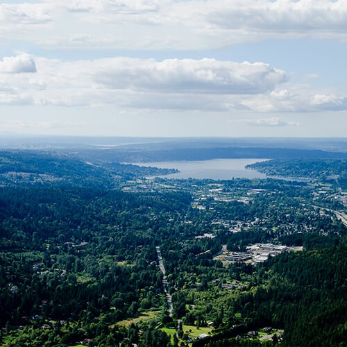 A photo from the top of Issaquah, showing its forests and a large lake