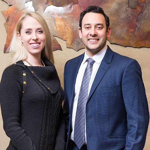 Our experts: Dr. Elisabeth Easley, and Dr. Neal Raval, inside the office, standing and smiling