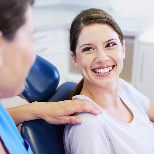 A woman relaxed in a dental treatment chair after receiving sedation dentistry in Issaquah, WA.