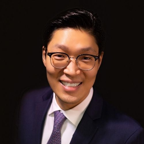 Periodontist, Dr. Eddie Lee, wearing a navy suit